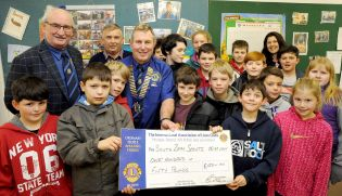 Presenting a Cheque for �150 to a local Scout Group