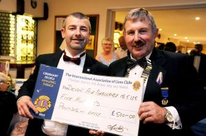 Cheque for £500 presented to Devon Air Ambulance